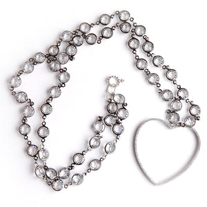 Clear quartz rosary chain paired with an open cut pave surround heart