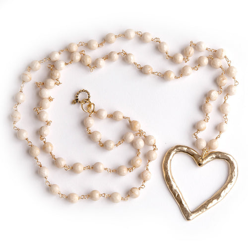 Cream coral rosary chain paired with an open cut bronze heart