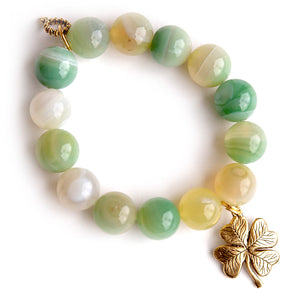 Light green striped agate paired with a brass shamrock