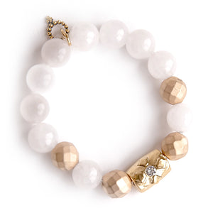 White jade paired with a brass barrel cross and matte gold faceted accents