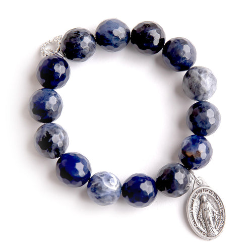 Faceted dumortierite paired with an oval Blessed Mother medal