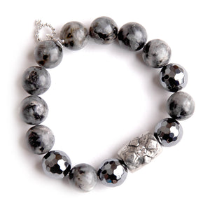 Charcoal grey jasper paired with a silver barrel cross and hematite accents