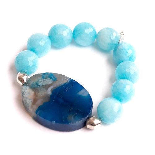 Tropical agate paired with an oval blue flower agate slice and Ethiopian silver accents