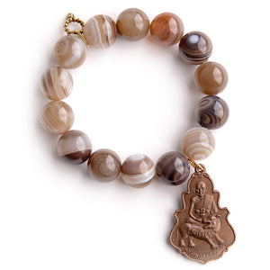 Brown swirl agate paired with a large bronze buddha medal