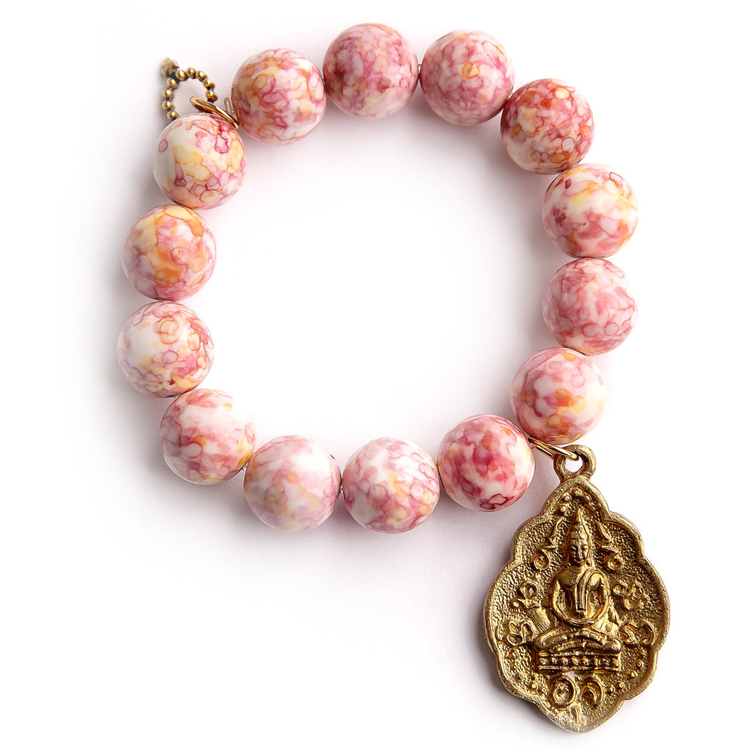 Pink and Yellow watercolor agate paired with a gold Buddha
