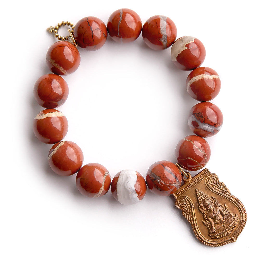 Red River agate paired with bronze shield Buddha