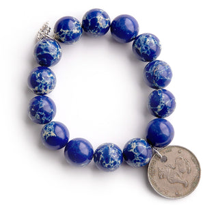 Royal Blue sediment jasper paired with a round Burmese coin