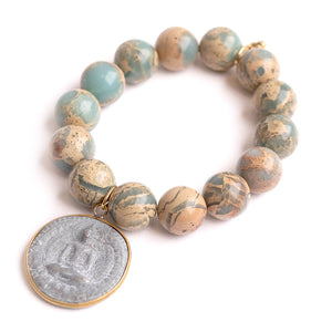 Aqua terra jasper paired with a brass surround slate buddha medal