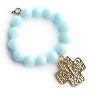 Aqua jade paired with a large brushed gold cross