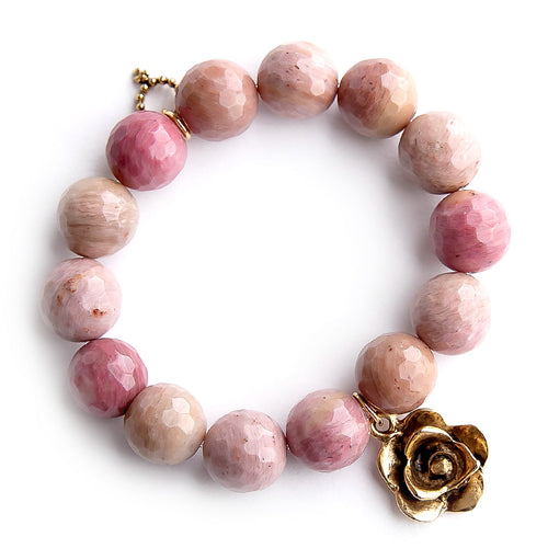 Faceted rhodochrisite paired with gold artisan flower