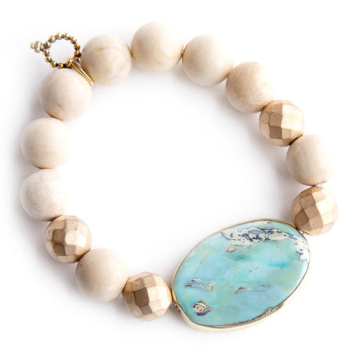 Aqua jasper with matte gold acccents on 12mm cream coral