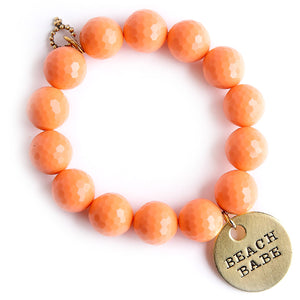 Faceted Mango Tango Agate paired with a bronze hand stamped Beach Babe medal
