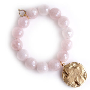 Faceted Iridescent Rose Quartz paired with a brushed bronze cross disc