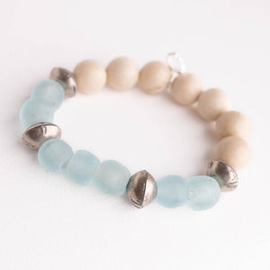Aquamarine sea glass paired with cream coral and Ethiopian silver accents
