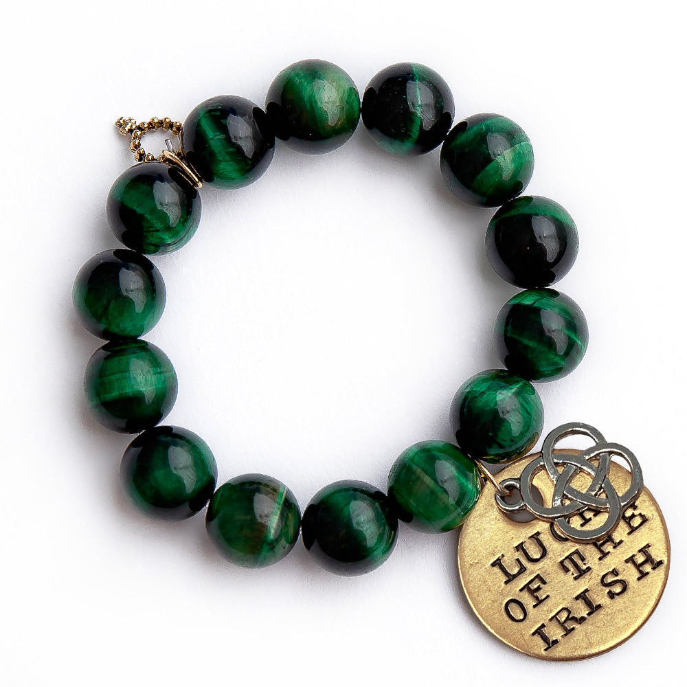Emerald tiger eye paired with a hand stamped bronze Luck of the Irish medal and a silver open cut Celtic cross