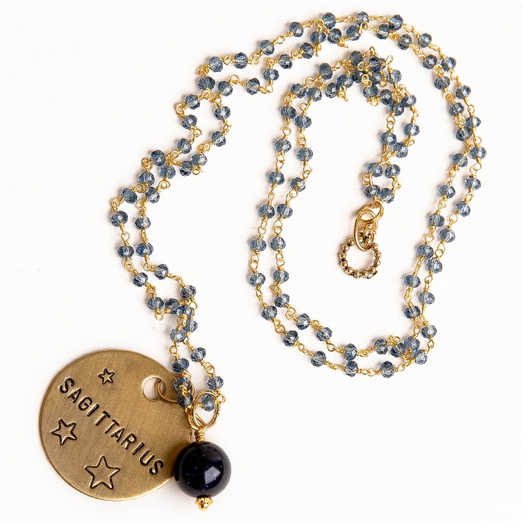 Blue quartz rosary chain necklace with navy goldstone accent and hand stamped bronze Sagittarius medal
