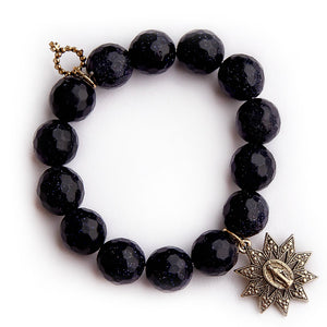 Faceted navy goldstone with gold starburst miraculous medal