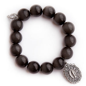 Black pearl calcite with ornate silver Blessed Mother medal
