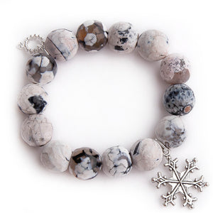 Faceted stormy agate with silver snowflake