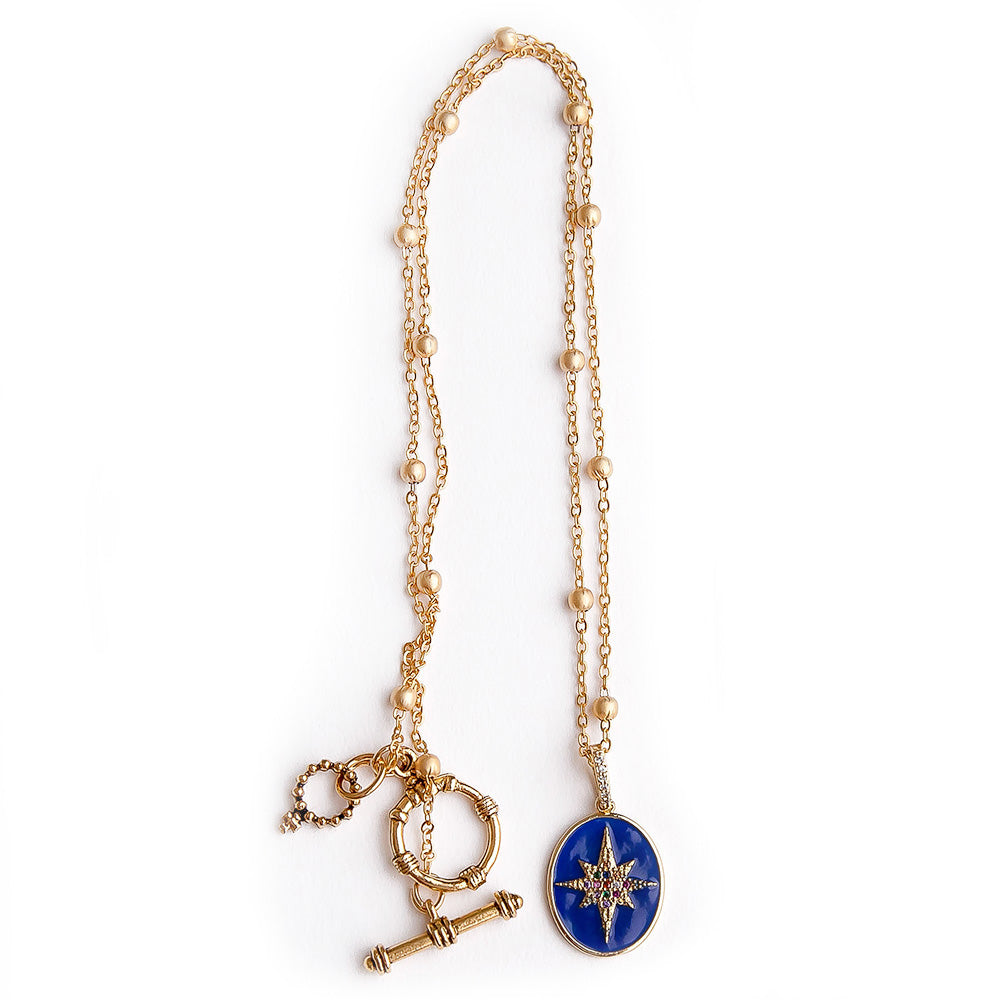 Matte gold ball chain necklace with navy enameled wish on a star pendant