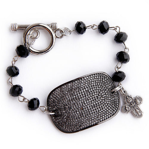 Faceted black onyx rosary chain with a gunmetal pave cuff and small silver cross