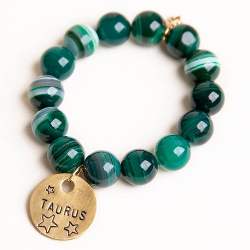 Emerald green striped agate paired with a bronze hand stamped Taurus medal