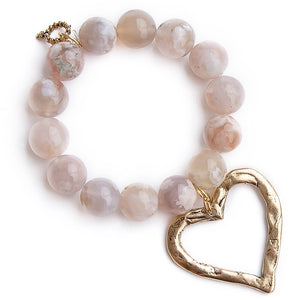 Smitten agate paired with a large brushed bronze open heart