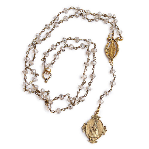 Faceted clear quartz and gold rosary chain necklace with gold Infant of Prague pendant