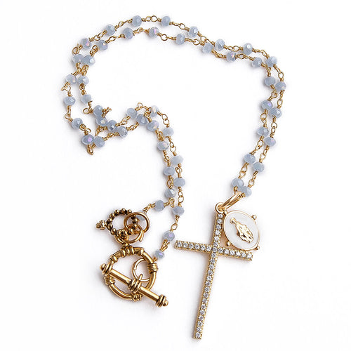 Faceted blue agate rosary chain with gold pave cross and white enameled mary