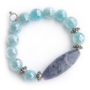 Faceted iridescent caribbean agate with fluorite barrel and silver accents