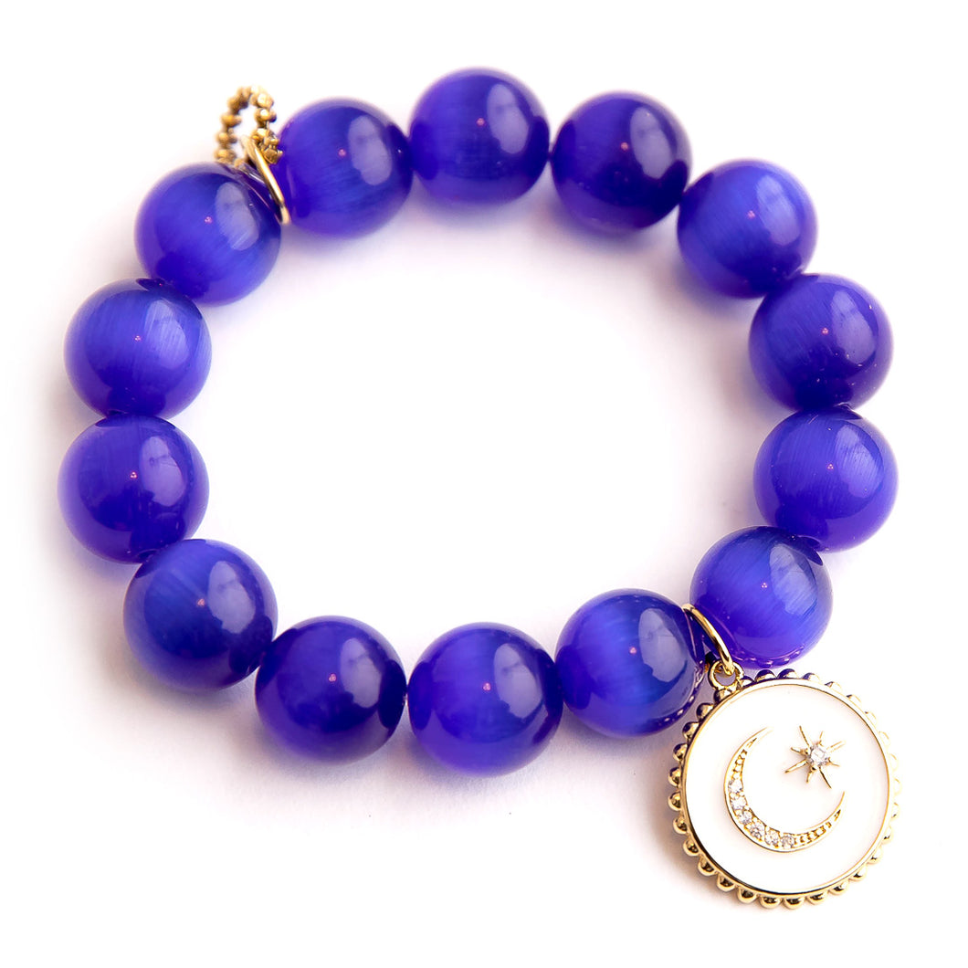 Royal blue calcite paired with an enameled celestial medal