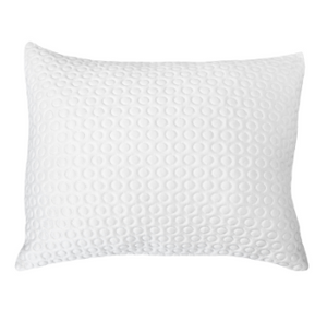 a white pillow with a circle pattern