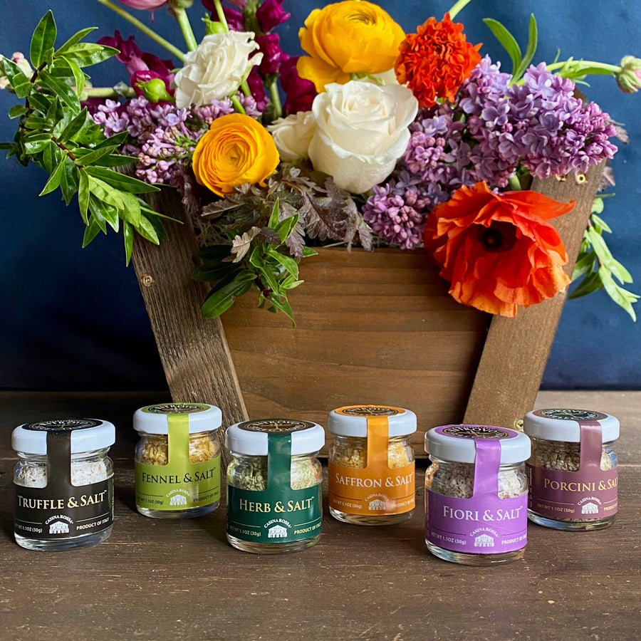 A custom handmade wooden gift basket by Seattle florist Campanula Design Studio. Includes a colorful bouquet of seasonal flowers and a set of mini salt jars.