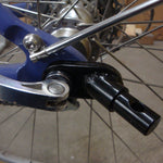 Axle hitch for attaching trailer to bicycle's wheel axle.