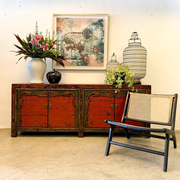 Our bergaya black teak and rattan stylish modern and contemporary chair pictured with red Chinese sideboard from Emperors Attic and artwork from Deborah Mckellar from talking textiles
