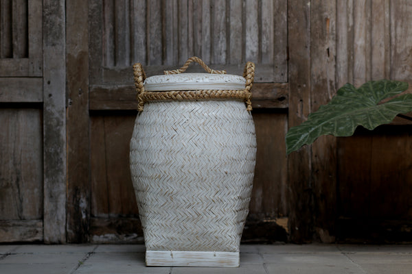 Stylish whitewashed woven bamboo laundry basket with rope lid and handles