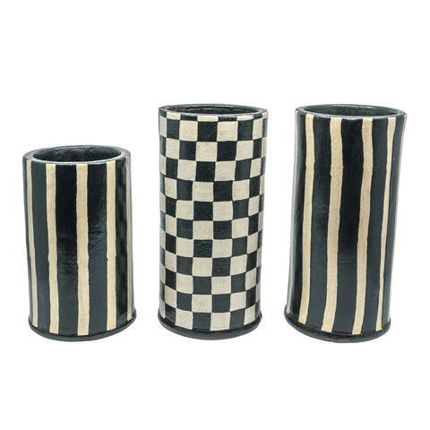 Poleng and Jalur Vase, in a black and white theme of vertical stripes and checkerboard effect.  Handmade batik covered terracotta. could be used for kitchen utensil jar