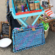 recycled bailing twine mat on display at market