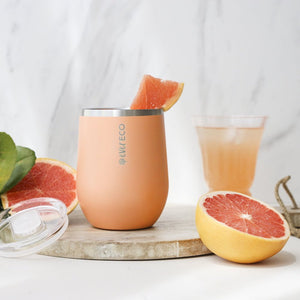 everECO Stainless Steel Insulated Mini Tumbler - Los Angeles with wedge of blood orange