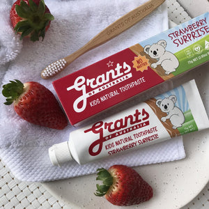 Grants Kids Toothpaste Strawberry Surprise on display with brush