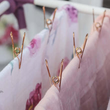 Rose Gold Stainless Steel 'Infinity' Pegs hanging