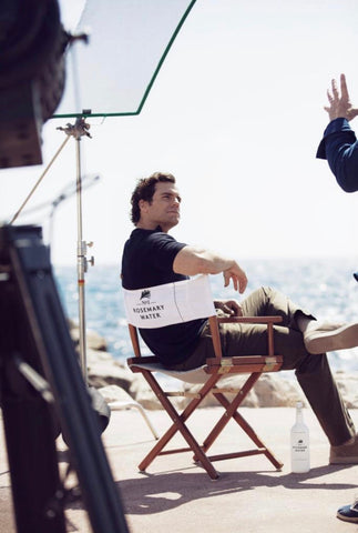 Henry Cavill sitting in the Director's Chair during filming
