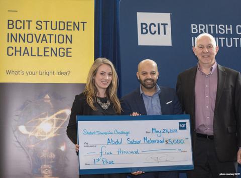 Saboor receiving an award from the Student Innovation Challenge