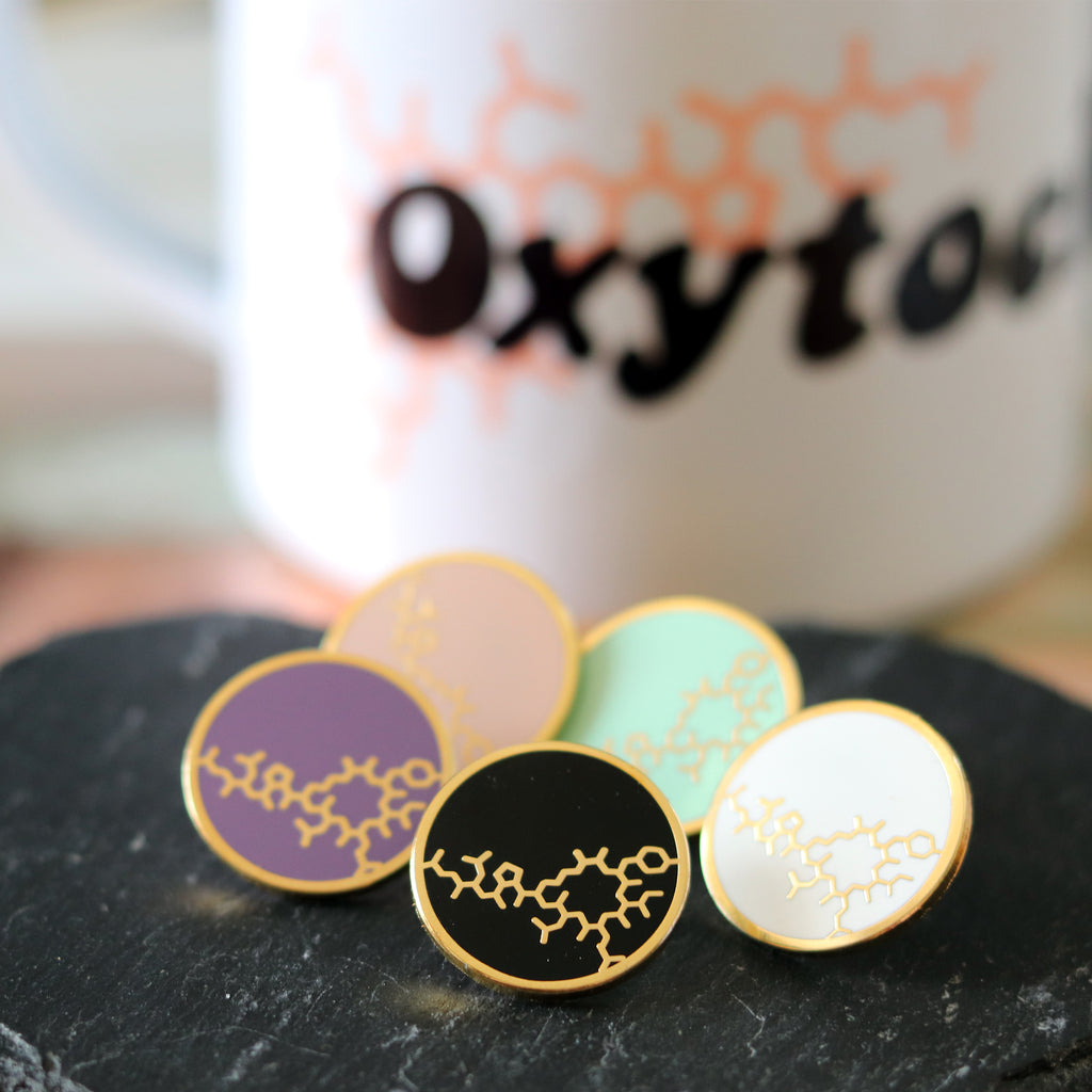 Oxytocin enamel pins by milk and moon
