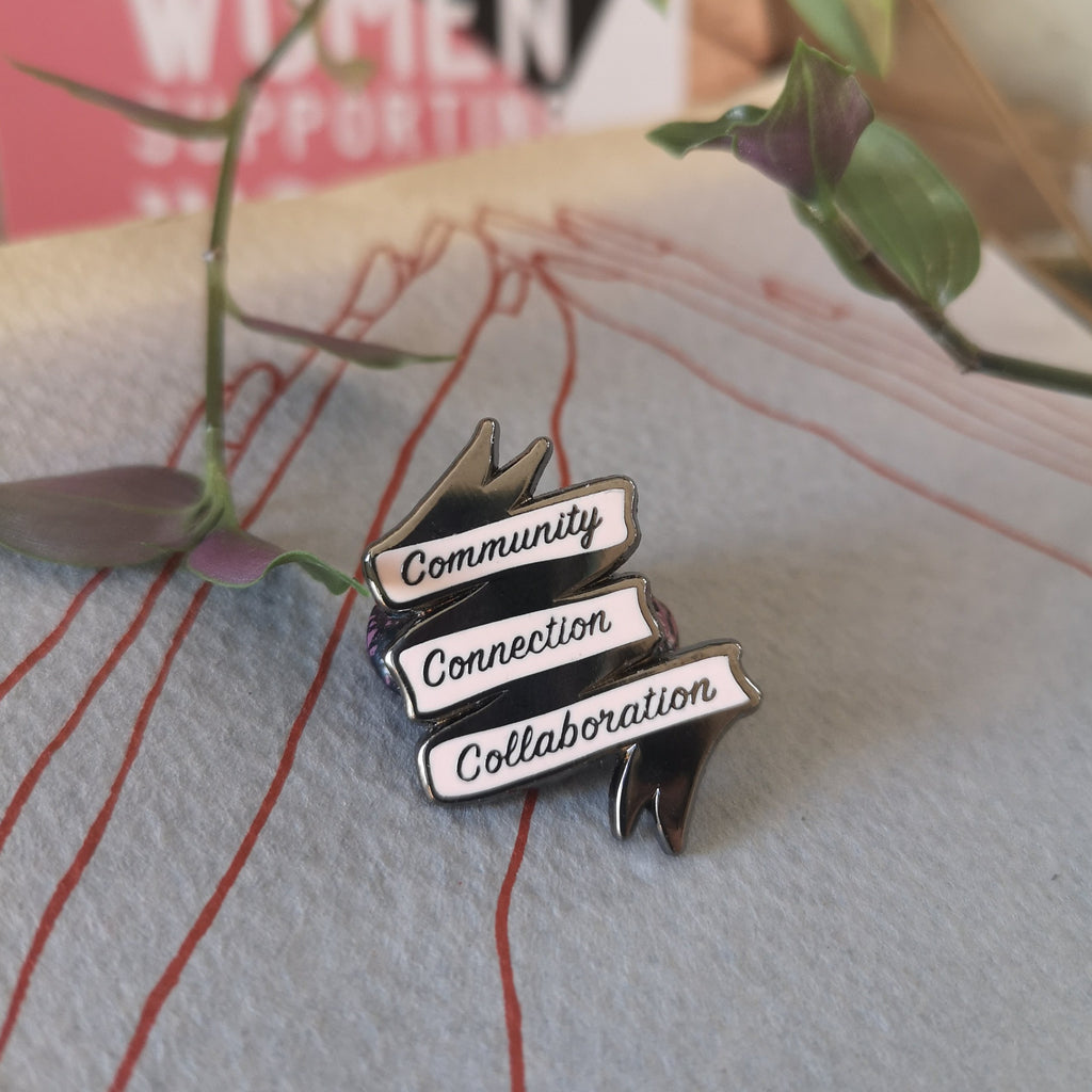 Community Connection Collaboration enamel pin by milk and moon