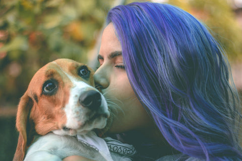 Woman with Purple Hair Kissing Dog
