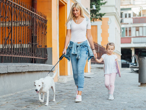 mother-walking-girl-to-school-with-dog
