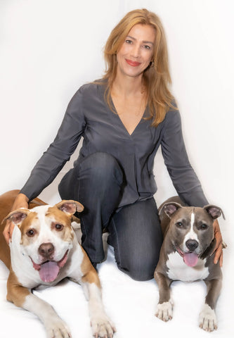 Certified Clinical Pet Nutritionist Johnna Devereaux and her two dogs