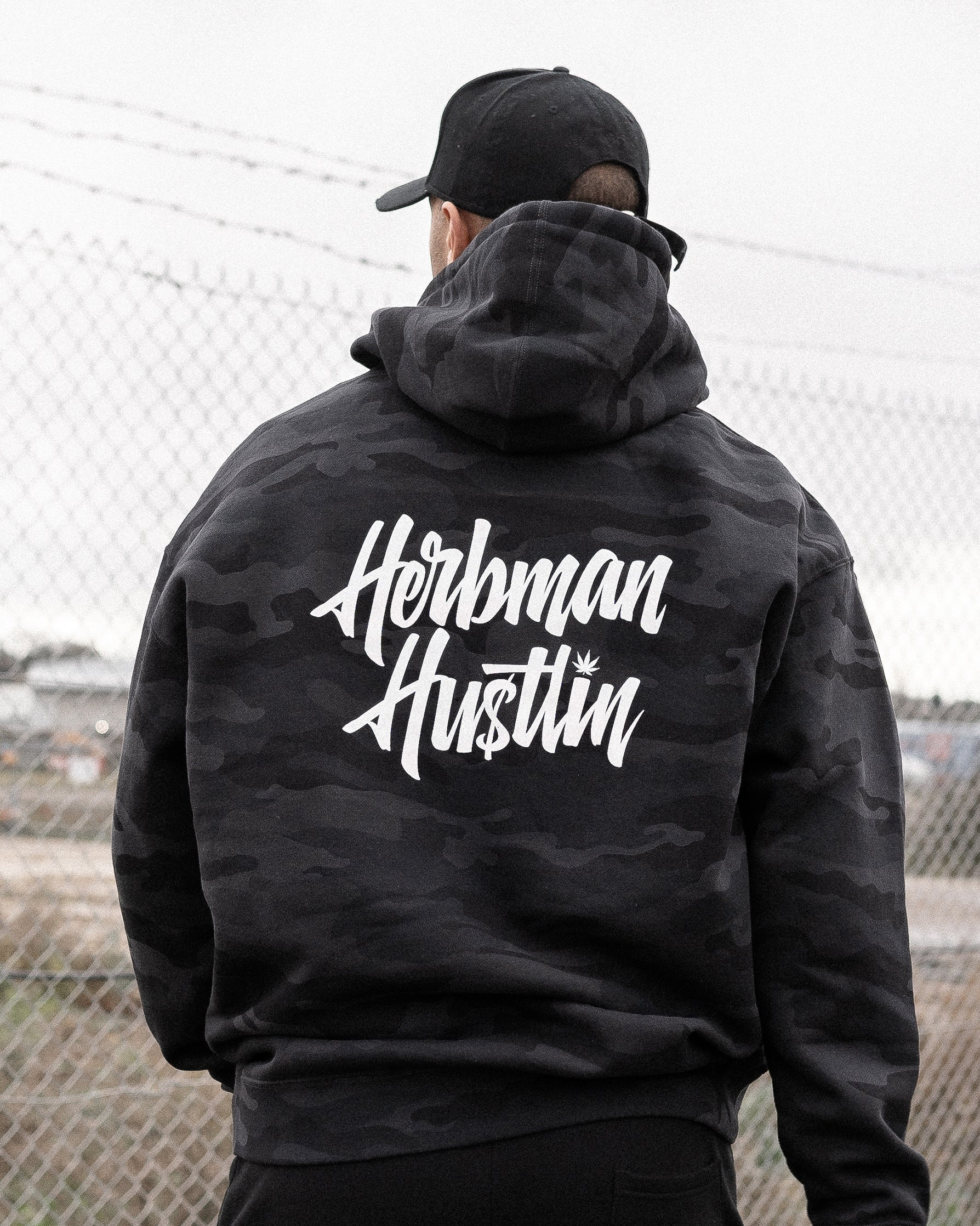Herbman Hustlin Script Heavyweight Hoodie - Black Camo/White