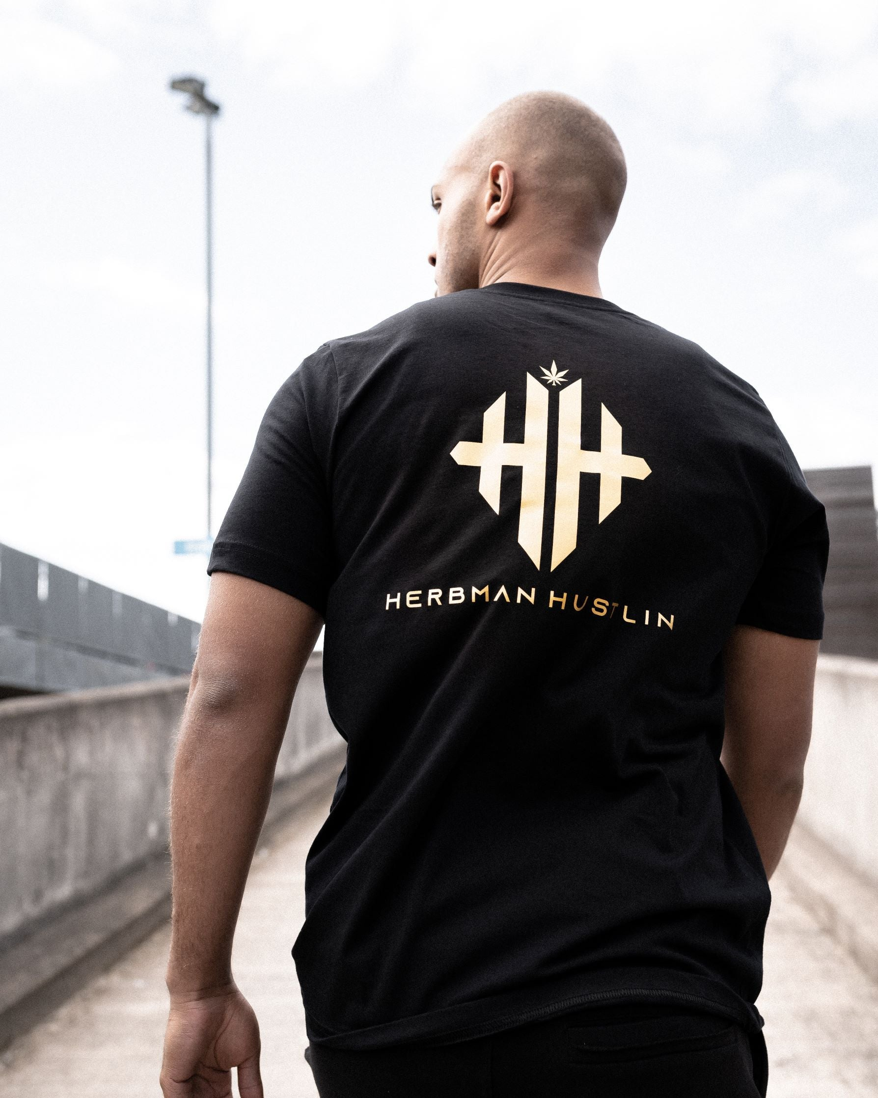 Herbman Hustlin Monogram Back Print Tee - Black/Gold - Back